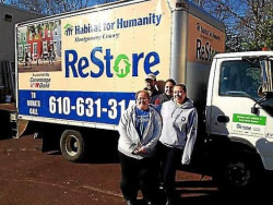 ReStore staff members Kathy Walsh, left, Brian Gillen, Abby Rambo and Erika Reinhard stand outside the West Norriton shop....