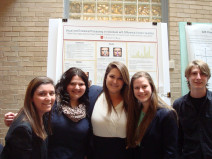 Research Students in front of poster session