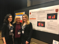 Victoria Javes, Sinead O'Callaghan, and Tatyanna Neumann presenting their research in Houston.
