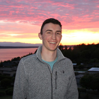 Dylan Stephens posing in front of a sunset