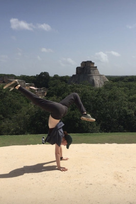 Student in front of Mayan ruins in Mexico