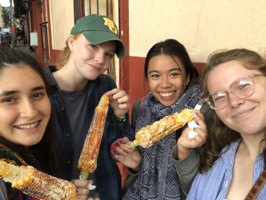 Students eating street corn in Mexico